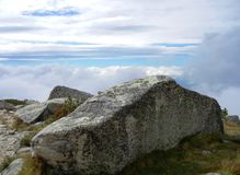 Lichen on stone and white clouds stock image