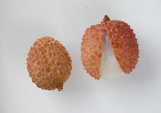 Lichi. Two pieces of lichi - tropical spinous fruit Royalty Free Stock Photography