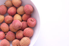 Lichi. In a bowl on bright backgruond Royalty Free Stock Images