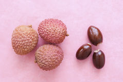 Lichi. Fresh Lichi on bright pink background Stock Images