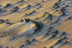Licht auf dem Sand Stockbilder
