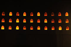 Licht in het gat op de muur Stock Foto