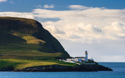 Licht huis op een eiland Stock Foto's
