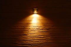 Licht op de muur Stock Foto