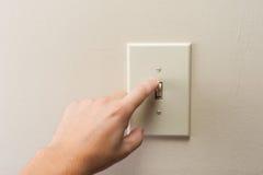 Licht van de hand schakelt het draaiende muur uit Stock Foto