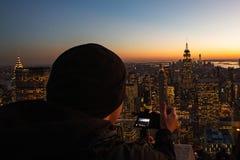 Licht van het leven bij zonsondergang van de stad van New York stock foto's