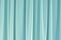 lichtblauw gordijn royalty vrije stock afbeeldingen