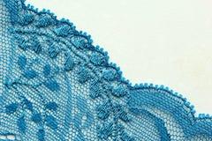 Lichtblauw materieel de textuur macroschot van het bloemenkant Stock Foto's