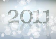 Lichtblauwe achtergrond met teken 2011 en fonkelingen Stock Afbeeldingen