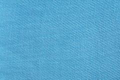 Lichtblauwe stoffenachtergrond Stock Foto