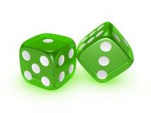 Lichtdurchlässige grüne Würfel auf weißem Hintergrund Lizenzfreies Stockfoto