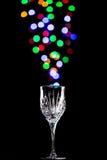 Lichte bellen die uit een wijnglas komen Royalty-vrije Stock Foto's