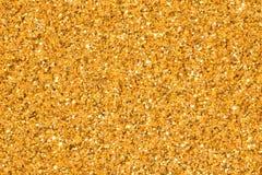 Lichte gouden schittert achtergrond met schittering Heldere gouden schittert textuur stock afbeeldingen