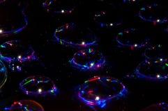 Lichte halo ` s op zwarte stock afbeeldingen