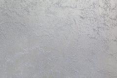 Lichte zandstroken op dark, staalachtergrond Decoratieve deklaag voor muren - zand Stock Afbeelding