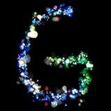 Lichten in de vorm van brieven Stock Foto's