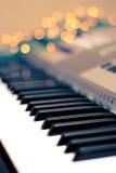 Lichten rond de piano Royalty-vrije Stock Foto's