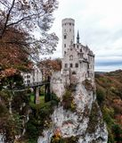 Lichtenstein Castle exterior in fall with dramatic cliffs. royalty free stock images