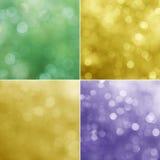 Lichter auf den violetten, grünen und gelben Hintergründen Lizenzfreie Stockfotos