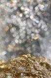 Lichter auf grauem silbernem Weihnachtshintergrund Lizenzfreie Stockbilder