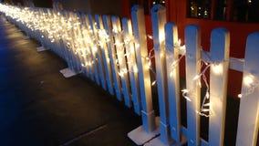 Lichter auf Zaun Stockbild