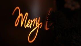 Lichter der frohen Weihnachten im Kerzenglas stock video