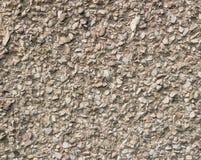 Lichtgrijze straaltextuur als achtergrond met kleine stenen Stock Foto