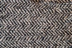 Lichtgrijze wollen of tweedstof voor grungeachtergrond stock afbeelding