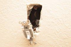 Lichtschalter-Reparatur Stockbild