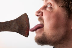 Licking on the Ax Royalty Free Stock Photography