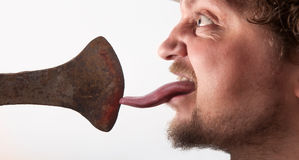 Licking on the Ax Stock Image