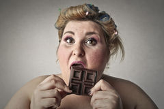 Licking chocolate royalty free stock images