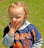 Licking hand. Young boy licking palm Royalty Free Stock Images