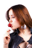 Licking lollipop woman on white Royalty Free Stock Photos