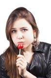 Licking lollipop woman on white Stock Photo