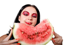 She licks her lips looking at the watermelon Stock Photo