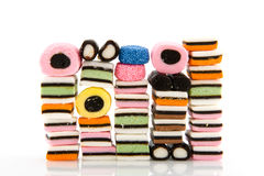 Licorice allsorts. Mixture isolated over white Royalty Free Stock Images