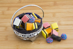 Licorice Allsorts in a Bowl on Wood Stock Photo