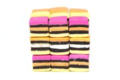 Licorice allsorts cube. Close up shot of licorice allsorts arranged in a cube isolated on a white background Stock Images
