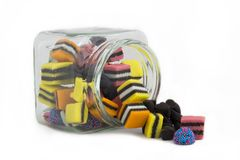 Licorice Allsorts in a Fallen Jar Stock Image