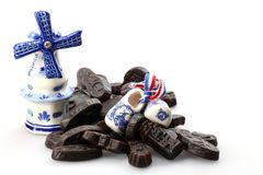 Licorice candies. Dutch licorice candies with Delftware souvenirs isolated on white background Stock Image
