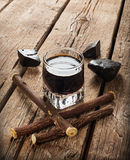 Licorice liqueur with pure blocks and roots. Royalty Free Stock Photo