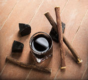 Licorice liqueur with pure blocks and roots. Stock Images