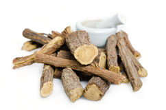 Licorice or liquorice root sticks isolated on white background Stock Photos