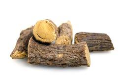 Licorice or liquorice root sticks isolated on white background Stock Photo