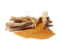 Licorice powder and roots Stock Image