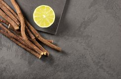 Licorice root and lemon - Glycyrrhiza glabra. Text space royalty free stock image