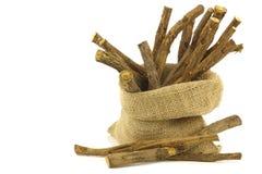 Licorice root (sticks) in a burlap bag Stock Photos
