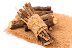 Licorice root sticks. Isolated on a white background Stock Photos