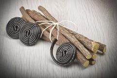 Licorice roots and licorice black Stock Image